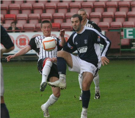 Joe Cardle challenges for the ball v Dundee