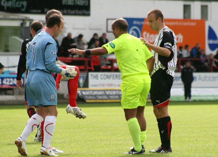 Referee Anthony Law is carried off